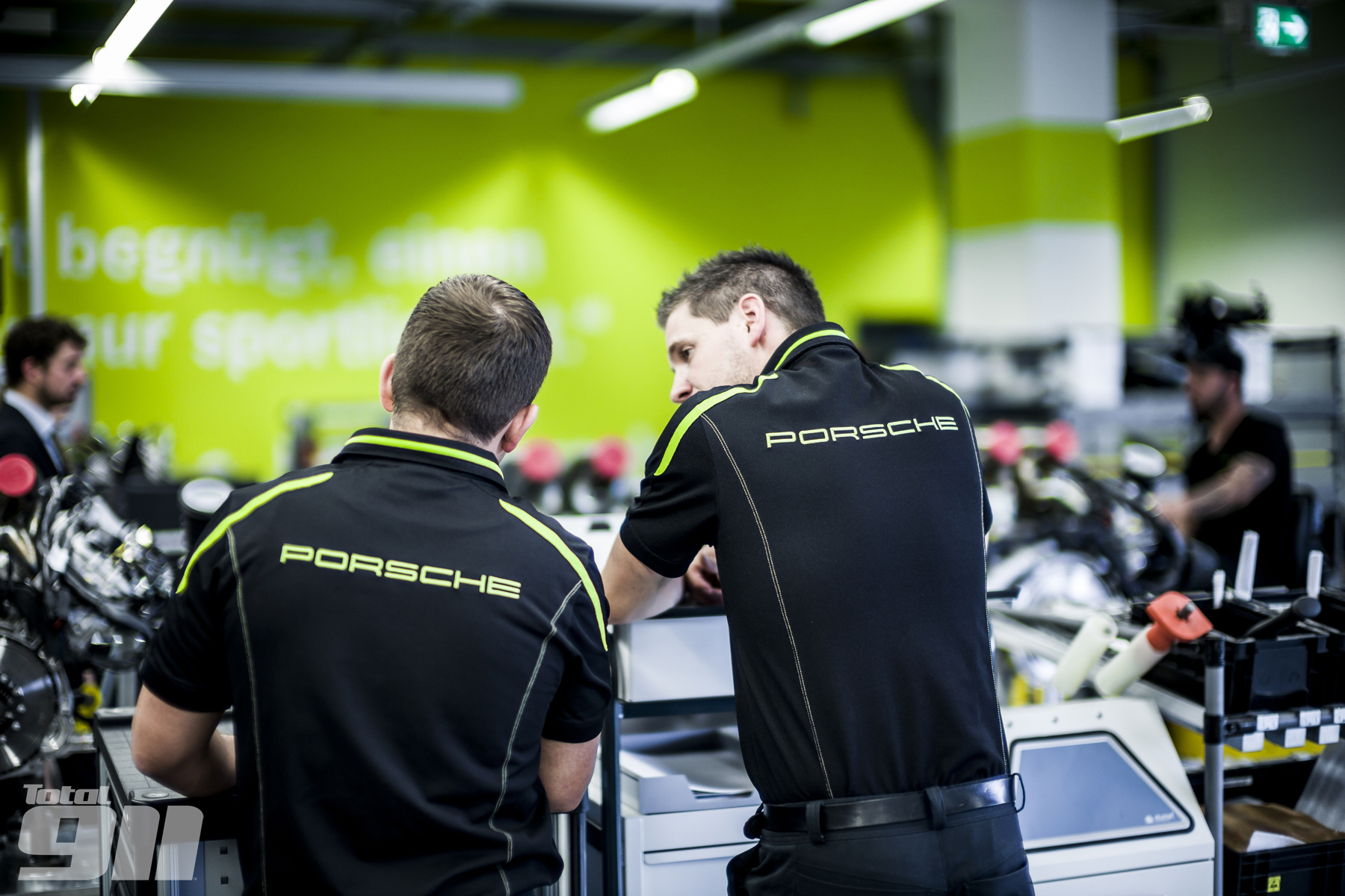 The 918 production line workers are the best of the best at Zuffenhausen. They wear their bespoke black-and-green uniform with immense pride.