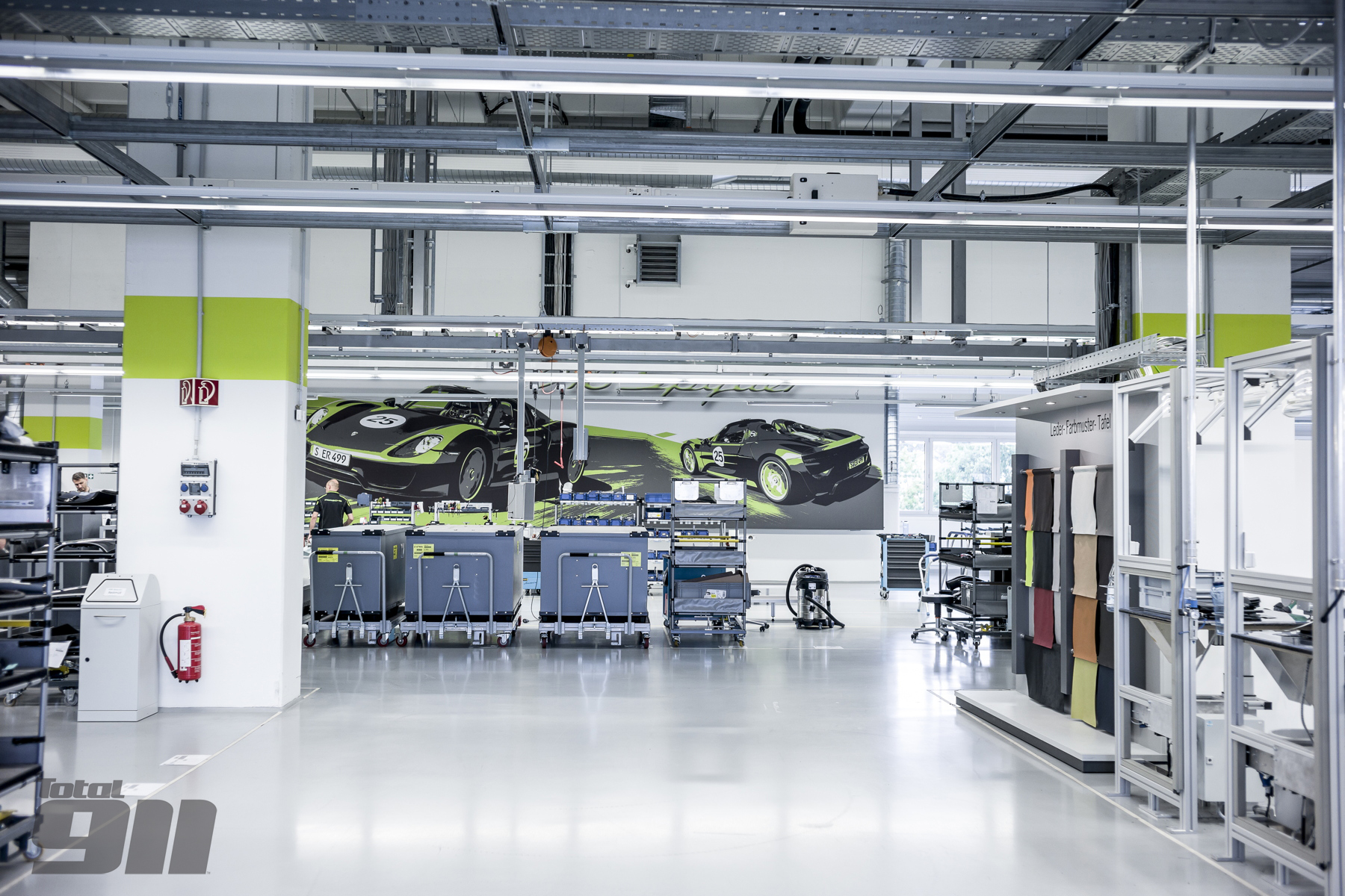 An eerily peaceful single room above the standard sports car production line, an unlikely venue for the birth of Porsche's first hypercar.