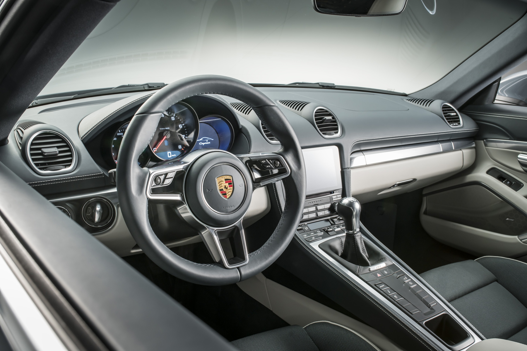 Inside, the new Cayman gets Porsche's latest treatment, complete with 918 Spyder-style steering wheel and the latest PCM with even more connectivity.